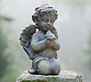 WEATHERED RESIN CHERUB W/BIRD FIGURINE