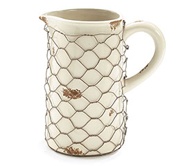 IVORY PITCHER WRAPPED W/CHICKEN WIRE