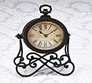 CLOCK BROWN ON SCROLL STAND