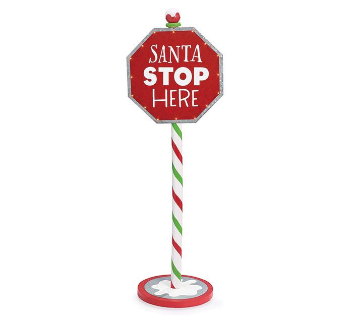SANTA STOPS HERE STOP SIGN