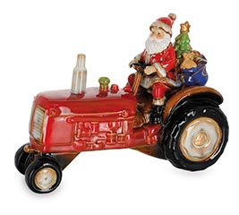 SANTA RIDING ON TRACTOR FIGURINE